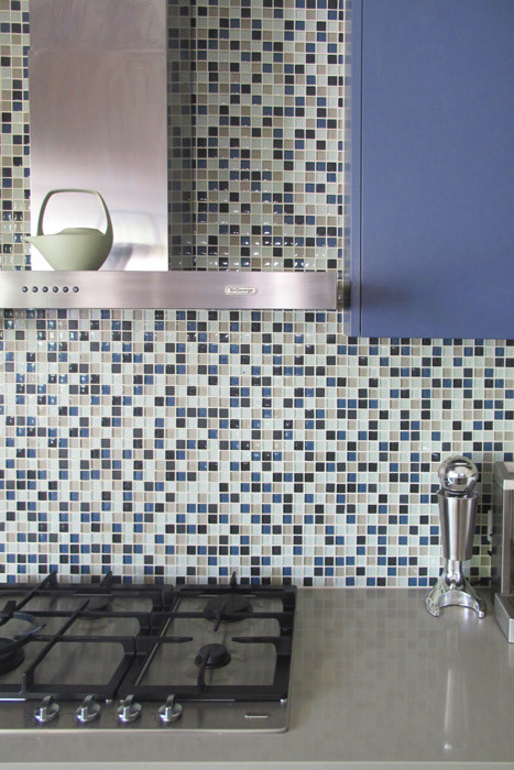Mosaic tiles and cabinetry work together.