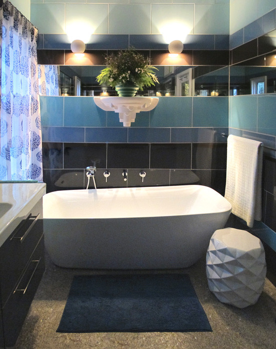 The mirror strip reflects light in this bold bathroom.
