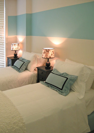 Matching beds in a BNB are  easily moved together to make a queen-size bed.