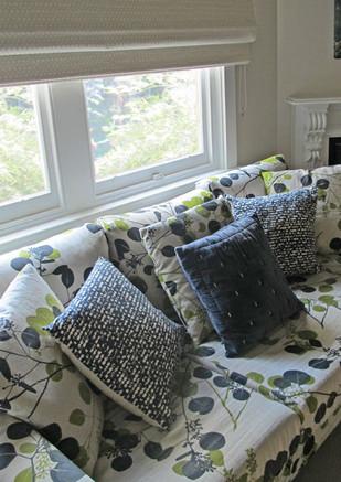 Custom screen-printed Belgian linen brought this sofa to life.
