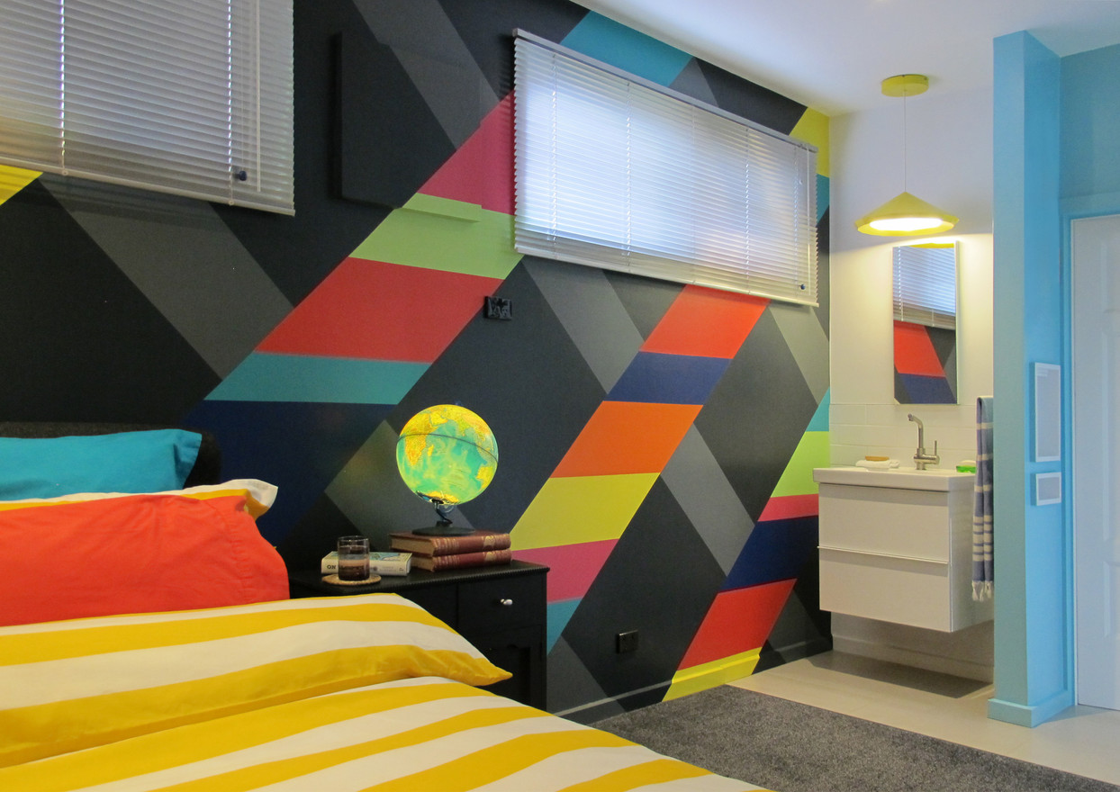 This hand-painted mural is the centrepiece of this bedroom.