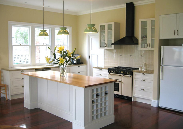 A timeless kitchen with unique pendant lights made from colanders.
