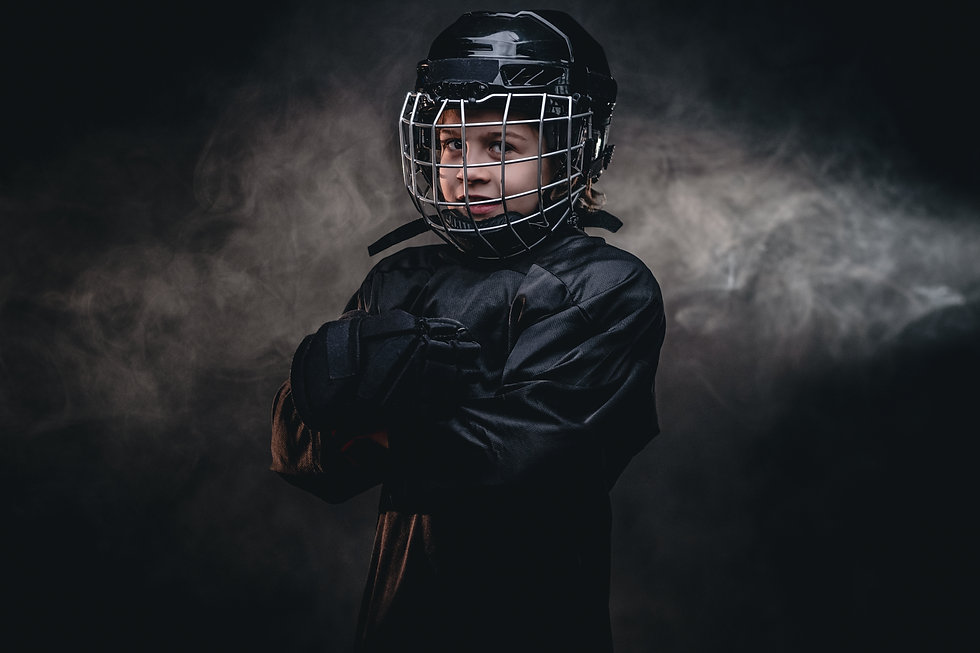 young-hockey-player-posing-in-uniform-fo