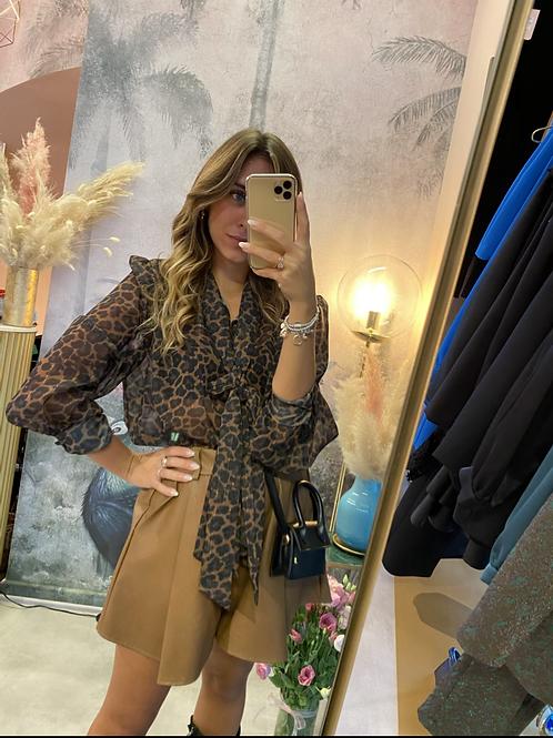 Camicia leopardata con fiocco al collo