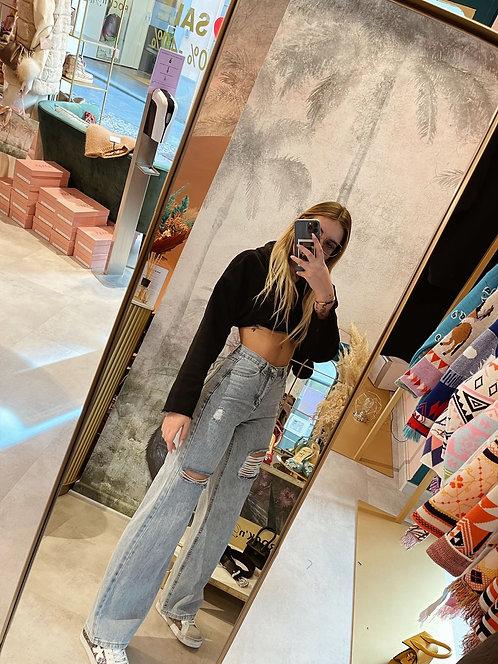 Jeans ampi con strappi