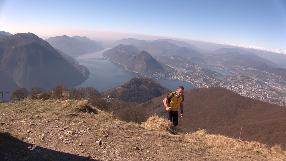 TrailPetsch running towards Monte Boglia with view towards Melide.