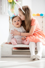 older-sister-kissing-her-younger-sibling