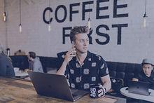 Entrepreneur on phone in coffee shop