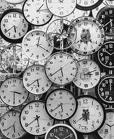 black-and-white-photo-of-clocks-707676.j