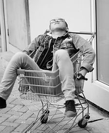 person-on-red-grocery-cart-2871490.jpg