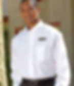 Link to the woven shirts page - Image of a Man wearing a white long sleeve woven work shirt with an embroidered logo over the left pocket - miami promo shirts