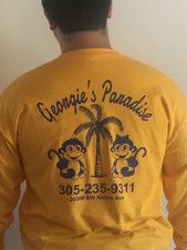 Image of a man wearing a yellow long sleeve cotton t-shirt with a custom screen printed logo on the back of the shirt