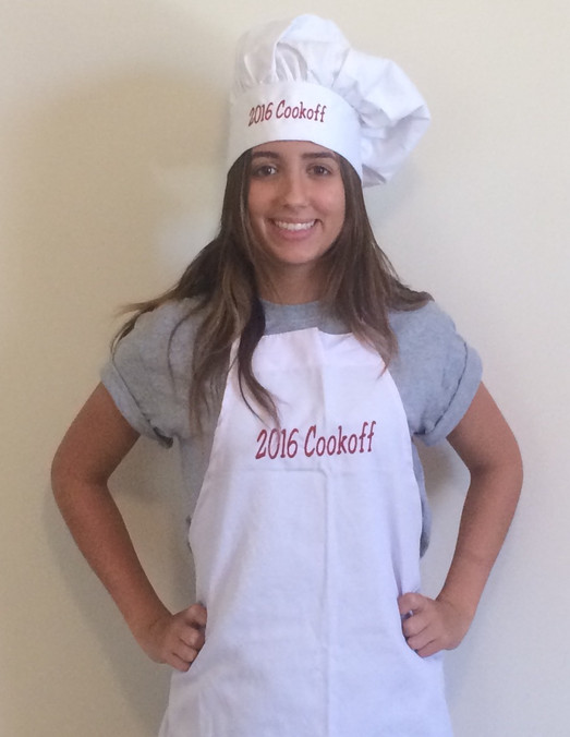 Young Lady wearing a white apen and a white chefs hat with a custom red embroidered logo on each one - miami promo shirts