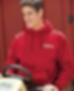 Link to sweatshirts page - Image of a Man wearing a red hoodie sweatshirt with an embroidered logo on the left chest - miami promo shirts