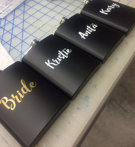 Image of black promo flasks with girls names on them which were used for a bridal shower - miami promo shirts