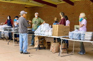 Feeding the Spirit volunteers organize meals to be distributed at St. Clair Park in Greensburg.