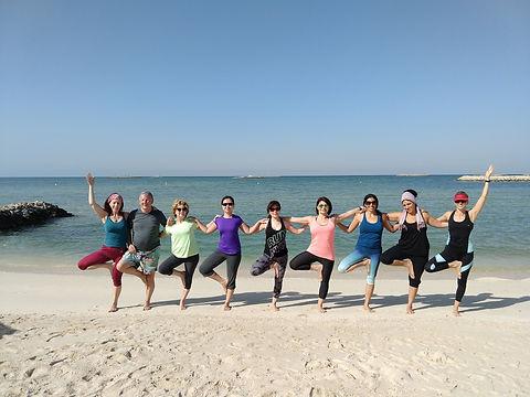 Group yoga tree pose Hawar 2018.jpg