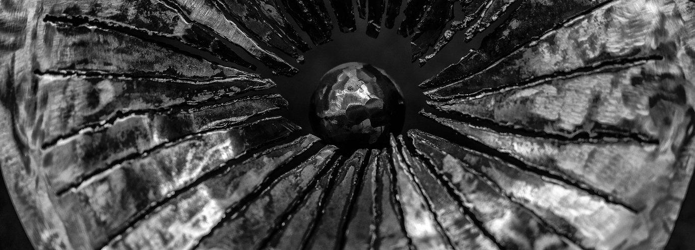 planet in metal , metal sculpture humanity