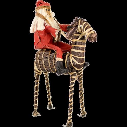Santa riding on a zebra