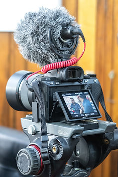 black-dslr-camera-on-black-tripod-stand-