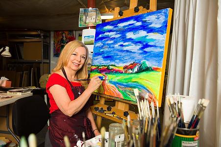 photo of Stacie Flint in her studio.jpeg