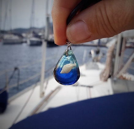 Blue teardrop resin pendant with tiny white shell