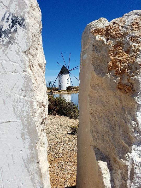 Windmill through stone wall
