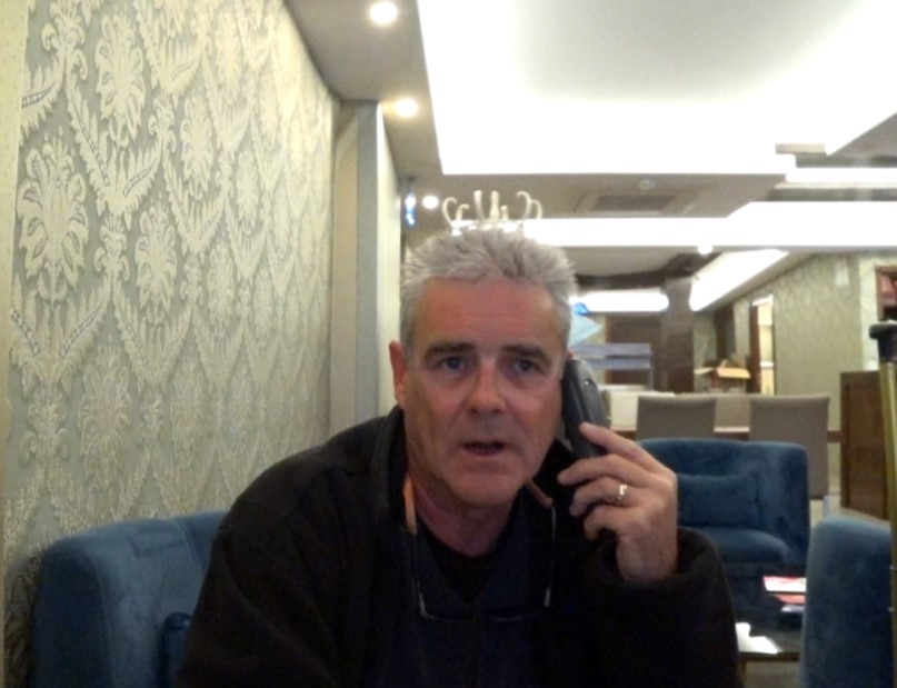 Baz on phone to Expedia