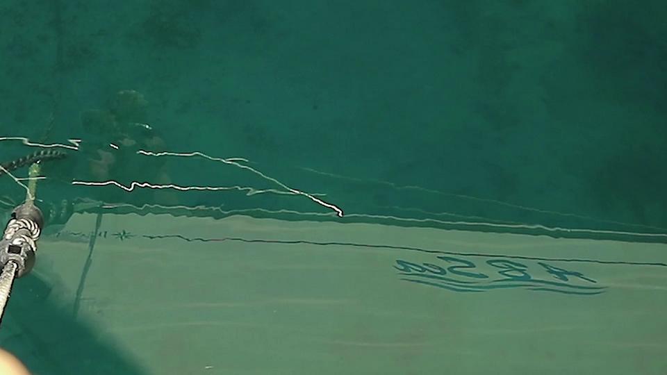 Anchor chain through clear water