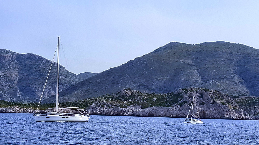 Jim in Acheron towing the little yacht to Datca