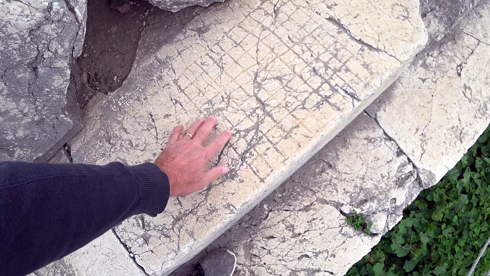 Gaming board scratched into temple steps