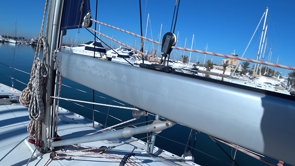 The boom of a furling mainsail