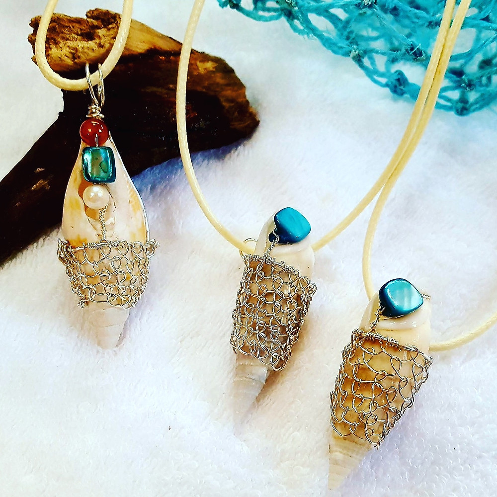 Three silver wire-wrapped Mitra shell pendants