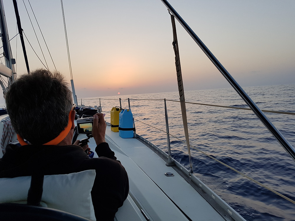 Baz snapping a sunrise on passage to Sardinia