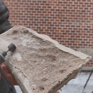 Machining a block of reinforced paper pulp material