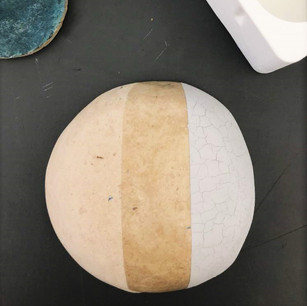 Three phases of finishing: sanded pulp surface, sealing starch coat, organic paint color coat