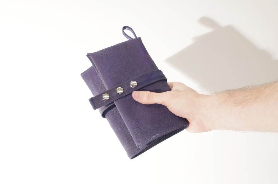 its exterior is made of waxed canvas, making it flexible yet waterproof and durable