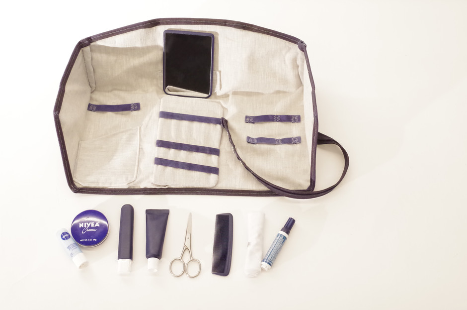 spruce would come with a set of grooming and hygiene items, but the linen & elastic interior is designed to be flexible for whatever products are the most useful