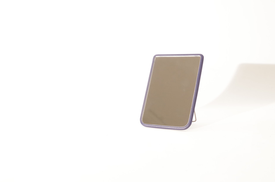 the shatter-proof acrylic and PLA mirror can both hang on a hook or stand independently