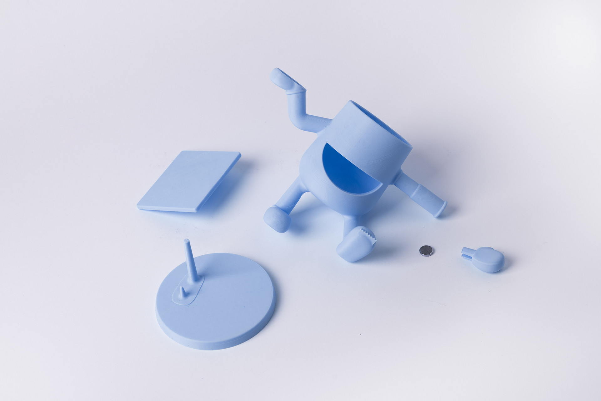a disassembled desk buddy showing distinct parts which snap together. this makes molding and interchanging parts easier, but also allows the product to be fully disassembled at end of life