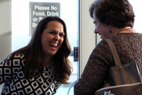 Exhibitor shares a laugh with attendee