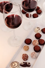 Delicious chocolates and glasses of wine