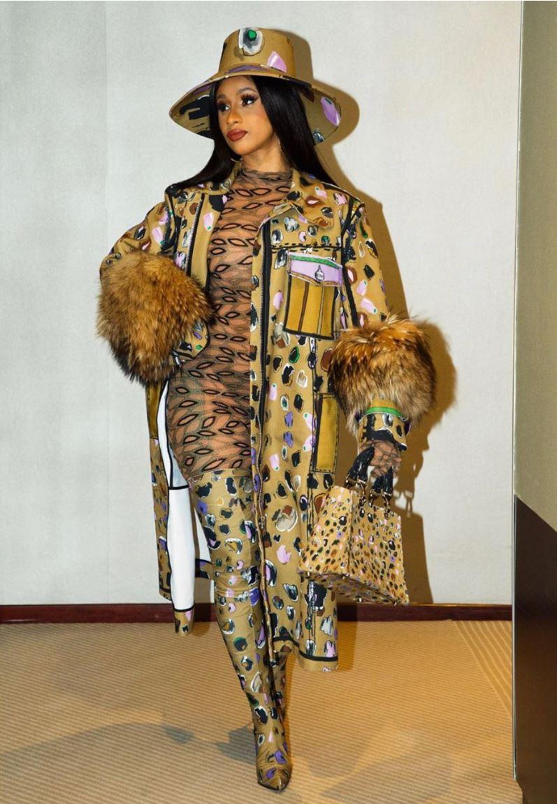 Cardi B attending Paris Fashion Week in EDDA jacket, boots and bag; and Aliette bodysuit.