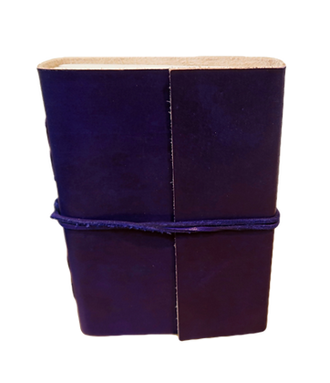 Large Journal in purple leather with 132 pages approx.