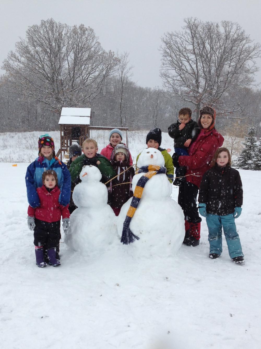 Snowmen Building with Friends
