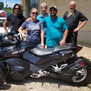A happy customer with her hubby and our crew. We hope she has many happy miles.