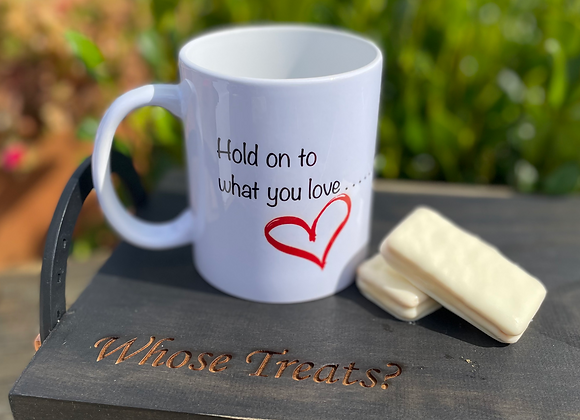 Whose Mug-Hold on to what you love...if it tries to buck you off hold on tighter