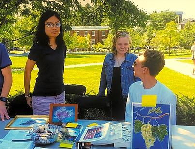 Members of Bowdoin College's College Guild club raise awareness at a volunteer fair