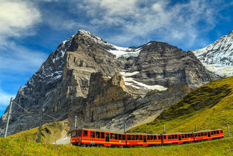 Famous electric red tourist train coming