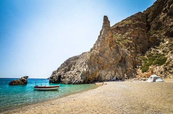 Agiaforago Gorge ends with a beautiful beach not too far from Matala, Crete, Greece. Grab a boat day trip and enjoy the caves, history & natural beauty.